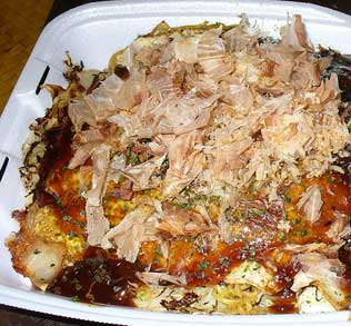 Hiroshima's special dish is Okonomiyaki. Heaps of cabbage is placed on thin crepes.